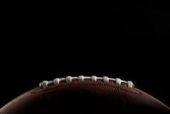American football. Close up of a football ball over black Stock Image