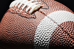 American Football. Shot on a black background with a stylish rim lighting effect. No logos or trademarks present stock photo