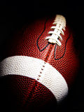 American football. Close-up of an American football against a dark background Stock Image
