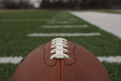 American Football. With the field in the background and room for copy Royalty Free Stock Photography