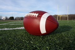 American football. Collegiate football on the field Royalty Free Stock Photo