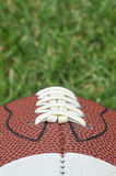 American Football. On grass close up of laces Royalty Free Stock Photography