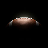 American football ball on black background. Concept Stock Photo