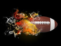 American football ball in the colored smoke Stock Photo