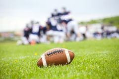 American football ball on the field Royalty Free Stock Photos