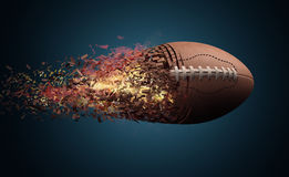 American football ball in fire. Flying Royalty Free Stock Photography