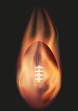 American Football ball with flame Stock Image