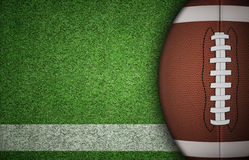 American Football Ball on Grass. American football ball on green grass and white line. with lots of copy space Royalty Free Stock Photography