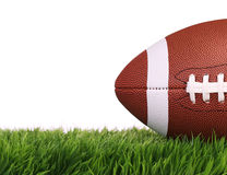 American Football. Ball on Green Grass, isolated