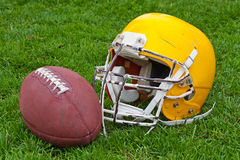 American football ball and helmet Stock Photos