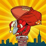 American football ball. Santa Claus with gifts climbs into the c stock illustration