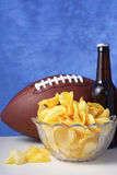 American football with beer and chips. Stock Photo