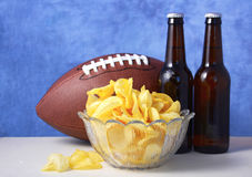 American football with beer and chips. Stock Images