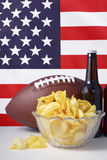 American football with beer and chips. Stock Image