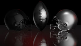 American football black and silver helmets on black dark background, 3d rendering. American football helmets, 3d render Stock Images