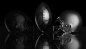 American football black and silver helmets on black dark background, 3d rendering. American football helmets, 3d render Royalty Free Stock Photography