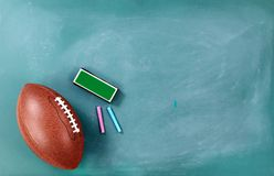 American football on chalkboard with eraser and chalk. American football on cleaned chalkboard with eraser and chalk stock image