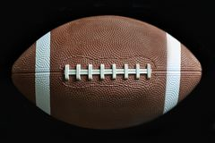 American Football. Close up of a American football on black background royalty free stock photos