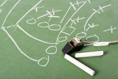 American Football Coaches Items. A football play diagram drawn with chalk on a chalkboard with chalk and a whistle stock image