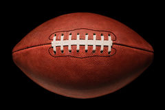 American Football in Deep Shadow Royalty Free Stock Images