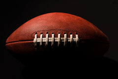 American Football in Deep Shadow Royalty Free Stock Photos