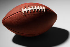 American Football with Deep Shadow Royalty Free Stock Photography