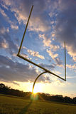 American Football End Zone Goal Posts at Sunset Stock Photos