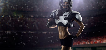 American football female player is posing Royalty Free Stock Images