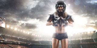 American football female player is posing Stock Photos