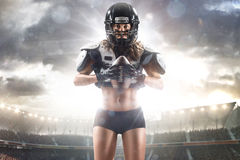 American football female player is posing Stock Photo