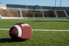 American Football on Field. With goal post in background Stock Images