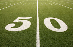 American Football Field 50 Yard Line Closeup. Closeup of 50 yard line on American football field Stock Image