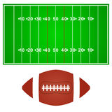 American football field with ball Royalty Free Stock Photo