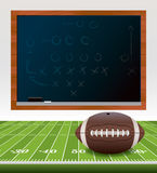 American Football on Field with Chalkboard. An illustration of an American football ball laying on a turf football field. Chalkboard with playbook drawn on it Royalty Free Stock Image