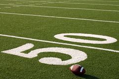 American Football on Field with copy space royalty free stock image