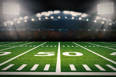 American football field. 3d rendering empty american football field with stadium Royalty Free Stock Photo