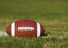 American Football on the field. With green grass Stock Photo