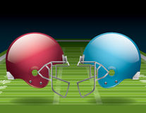 American Football Field and Helmets. A vector illustration of an American Football field and helmets. EPS 10. File contains transparencies. Gradient mesh only Stock Image