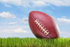 American football on a field outdoors Stock Image