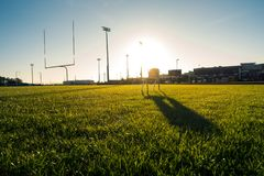 American Football Field Outdoors Goal Posts Green Grass Beautiful Day stock photo