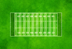 American football field. Overhead view of American football field on textured green background Royalty Free Stock Photos