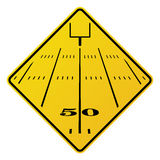 American Football Field Road Sign Illustration. An yellow road sign containing an American football field and field goal. Vector EPS 10 available Stock Photography