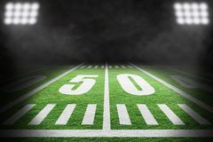 American Football Field With Stadium Lights and Smoke stock images