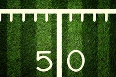 American Football Field 50 Yard Line Closeup. Closeup of 50 yard line on American football field Royalty Free Stock Image