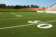American Football Field Yard Lines. American football field with goal post in background Stock Photos