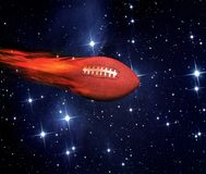 American Football Flying. America football flying fast and on fire in outerspace stock photos