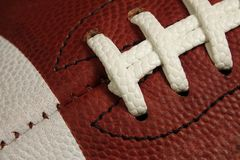Macro View of an American Football Game Ball Laces and Stripes Royalty Free Stock Photography