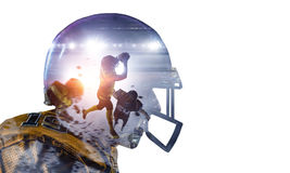 American football game . Mixed media. Double exposure of american football players on white background. Mixed media Stock Images