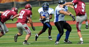 American football game - running back rushing Royalty Free Stock Images