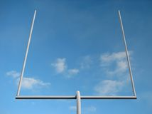 American football goal post. American football field goal posts against the blue sky royalty free stock photography